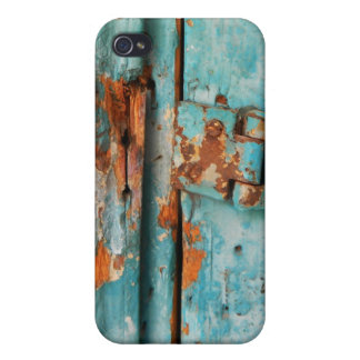 Old blue wooden door with rusted latch cover for iPhone 4