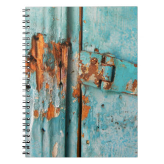 Old blue wooden door with rusted latch notebook