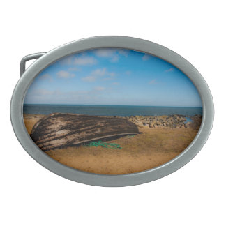 Old boat on the shore oval belt buckle