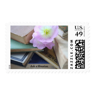 Old books with pink flowers postage stamp