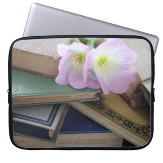 Old books with primroses computer sleeve