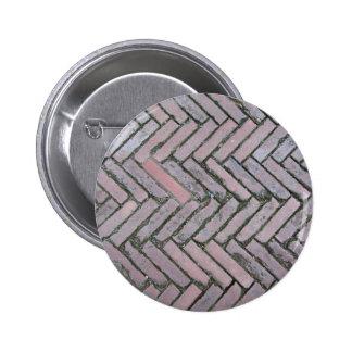 Old brick footpath background 2 inch round button