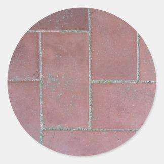 Old brick footpath background classic round sticker