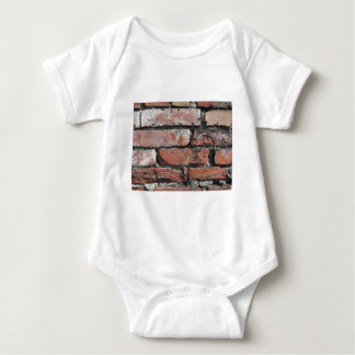 Old brick wall background baby bodysuit