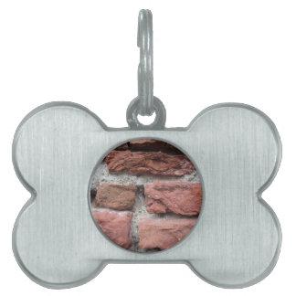 Old brick wall background pet ID tag