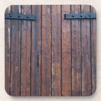 Old Brown Wood Doors With Black Iron Supports Drink Coaster