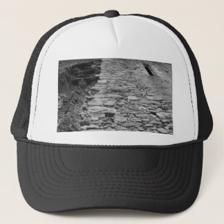 Old building. Tall Stone Wall. Trucker Hat