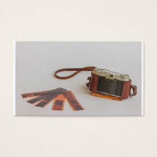 old camera with negative on   business card