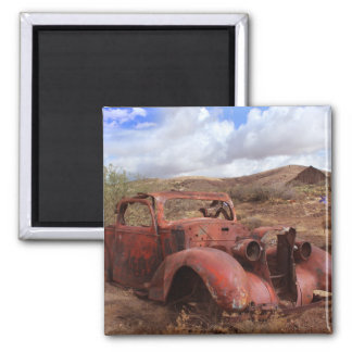 Old Car Rusting In Desert Landscape Magnet