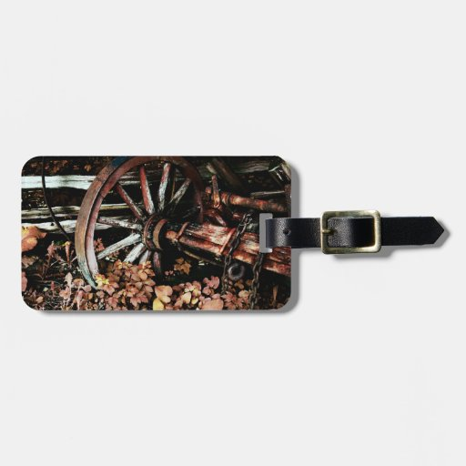 old cart wheel luggage tag