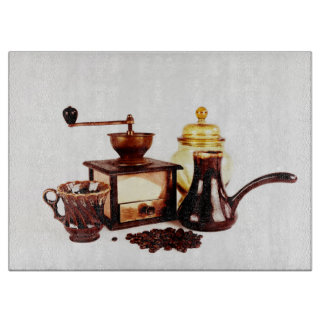 old coffee mill and coffe beans cutting boards