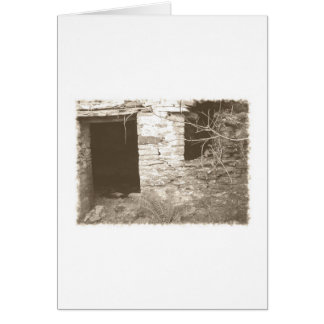 Old cottage in the woods. Sepia and white. Card