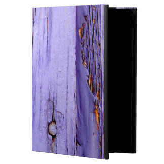 Old cracked purple paint on wood cover for iPad air