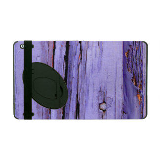 Old cracked purple paint on wood iPad cover