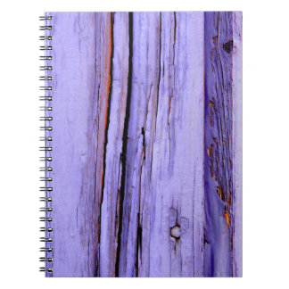 Old cracked purple paint on wood notebook