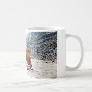 Old Damaged Excavator Sitting In A Rock Quarry Coffee Mug