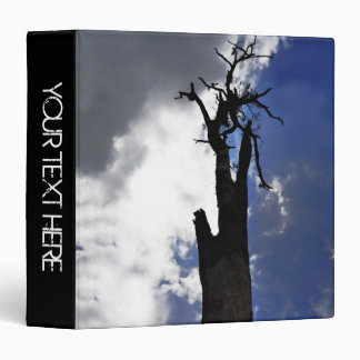 Old dead tree against dark cloudy sky binder