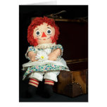 old doll with daisy card