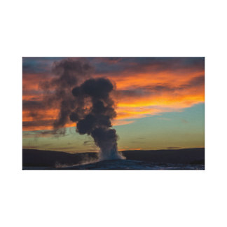 Old faithful geyser at sunset in Yellowstone park Canvas Print