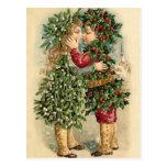 Old Fashion Holly Kids Kissing Christmas Postcard