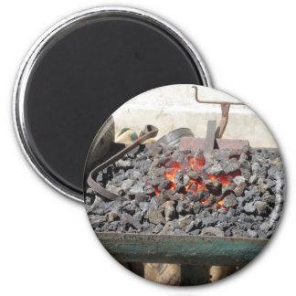 Old-fashioned blacksmith furnace . Burning coals Magnet