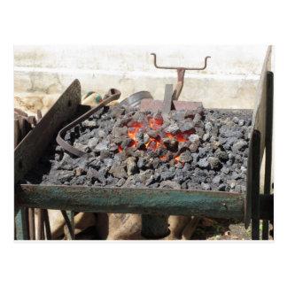 Old-fashioned blacksmith furnace . Burning coals Postcard
