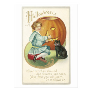 Old Fashioned Halloween Boy Carving Pumpkin Postcard