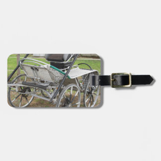 Old-fashioned horse carriage on green background luggage tag