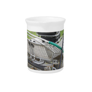 Old-fashioned horse carriage on green grass beverage pitcher