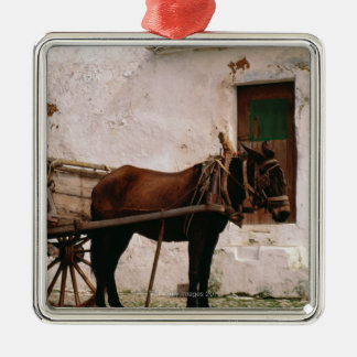 Old-fashioned horse-drawn cart metal ornament
