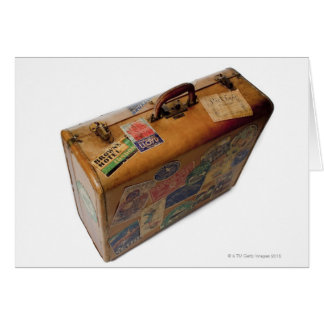 old fashioned suitcase with travel stickers greeting card