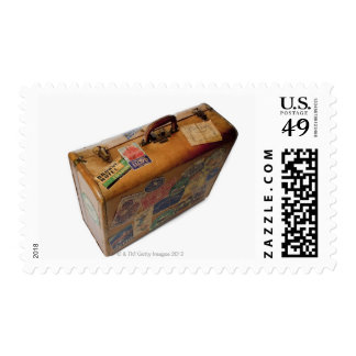 old fashioned suitcase with travel stickers postage stamp