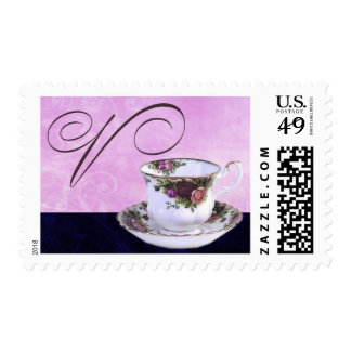 Old fashioned teacup with pink swirls postage stamps