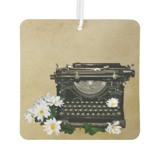 Old fashioned typewriter and daisies air freshener