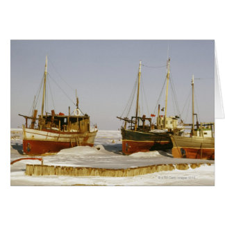 Old-fashioned, weathered fishing boats beached card