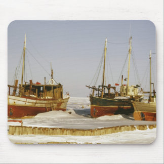 Old-fashioned, weathered fishing boats beached mouse pad
