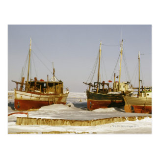 Old-fashioned, weathered fishing boats beached postcard