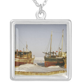 Old-fashioned, weathered fishing boats beached silver plated necklace