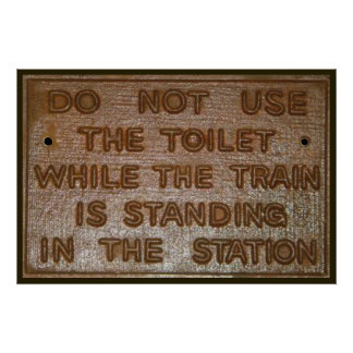 old funny train toilet sign