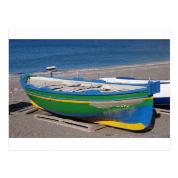 Beach Themed Old green fishing boat on beach. postcard