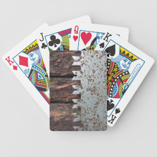 Old hand saw on log cabin bicycle playing cards