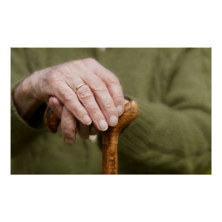 old hands OF A senior lean on walking stick Posters