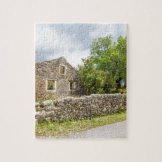 Old historic house as ruins along road jigsaw puzzle
