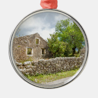 Old historic house as ruins along road metal ornament