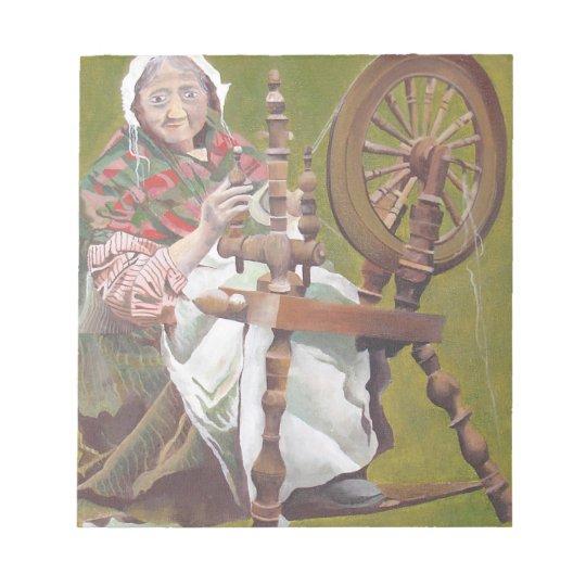Old Irish Woman Sitting At A Spinning Wheel Notepad