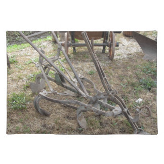 Old iron plow and other agricultural tools placemat