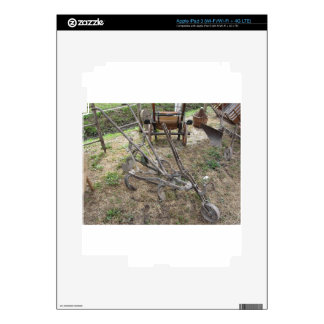 Old iron plow and other agricultural tools skin for iPad 3