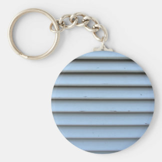 Old jalousie window with wooden slats gray painted basic round button keychain