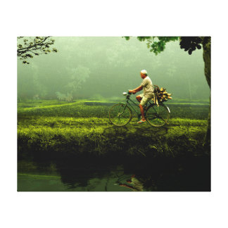 Old man on a bicycle canvas prints
