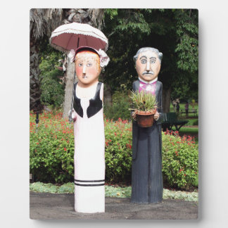 Old married couple sculptures plaque